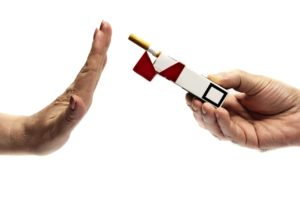 Woman hand refusing cigarette pack